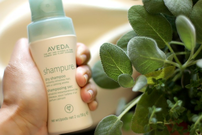 Shampure Dry Shampoo by Aveda This is a non-aerosol powder mist that absorbs excess oils and lifts impurities away from the hair. It is a 99.8 percent naturally derived formula. Because of it's scent it's like a relaxing Sunday afternoon at the spa.