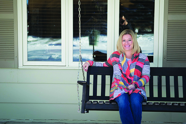 Shannon Pippin sits on her porch swing outside her Great Falls home.